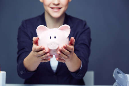 Female hands holding piggy bank photo