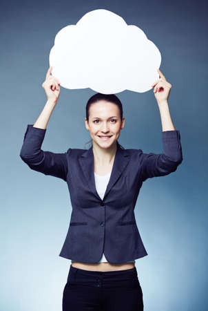 Pretty businesswoman showing blank speech bubble and looking at camera photo