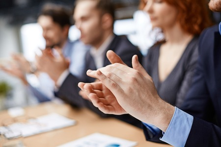 conference: Male hands applauding at conference Stock Photo