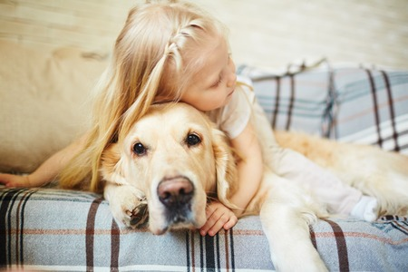 petting: Cute child resting with dog Stock Photo