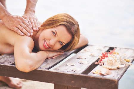 relax massage: Young woman enjoying outdoor massage Stock Photo