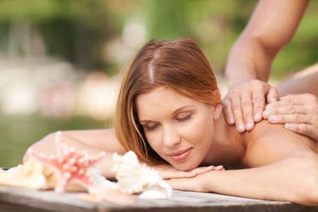 spa and resort: Peaceful woman enjoying massage at spa resort