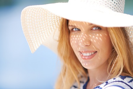 sunhat: Cute female in sunhat looking at camera Stock Photo