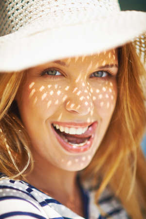 flirty: Flirty girl in sunhat looking at camera Stock Photo