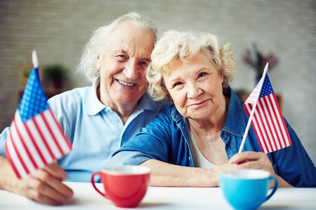 Happy seniors with American flags