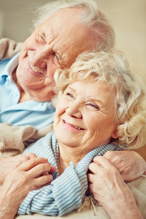 old women: Affectionate grandparents enjoying being together Stock Photo