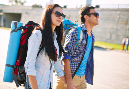 rucksacks: Young couple with rucksacks sightseeing