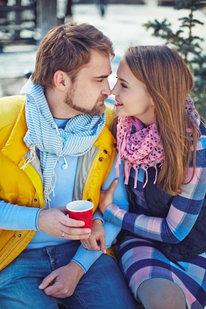 sweethearts: Happy young sweethearts flirting outdoors