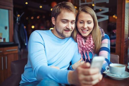 sweethearts: Romantic couple enjoying time in cafe Stock Photo