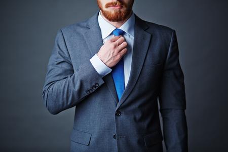 coat and tie: Close-up of businessman in elegant suit