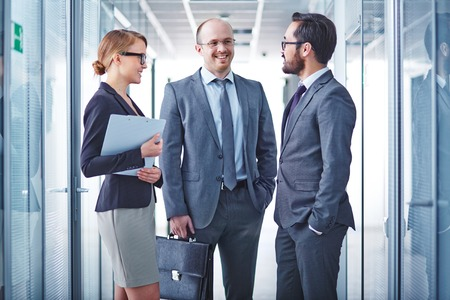 handsome business man: Group of successful business partners having meeting