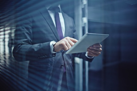 elegant business man: Close-up of businessman using touchpad