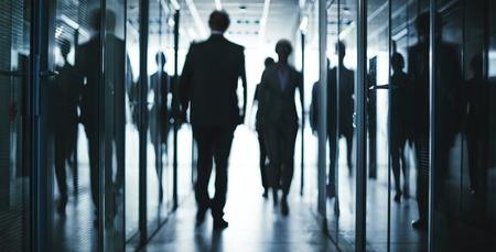 people walking: Several employees going inside office building Stock Photo