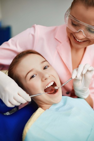 young: Little girl having oral checkup Stock Photo