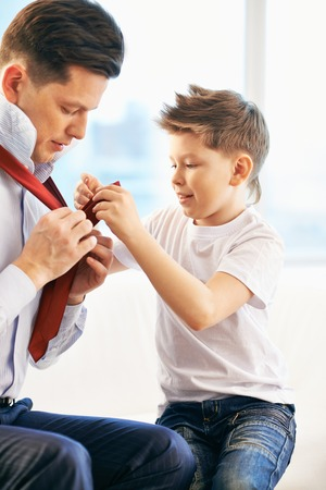 getting dressed: Father and son getting dressed