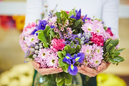 chrysanthemums: Florist hands with big floral bouquet Stock Photo