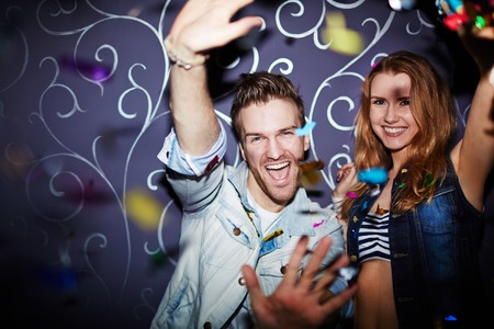 ecstatic: Ecstatic couple having fun at party Stock Photo
