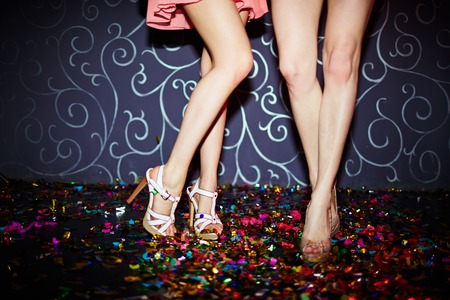 dancing club: Legs of two girls dancing in night club
