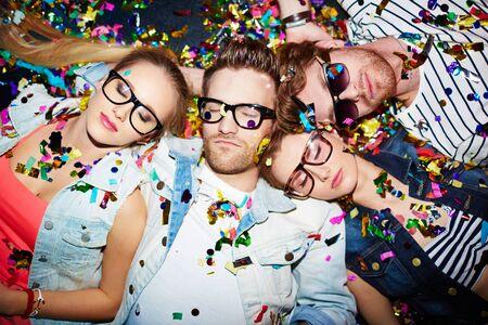 slumber party: Sleeping friends lying on the floor in nightclub