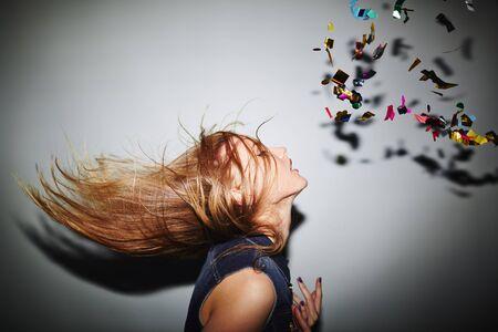 energetic people: Energetic female dancer with blond hair in nightclub