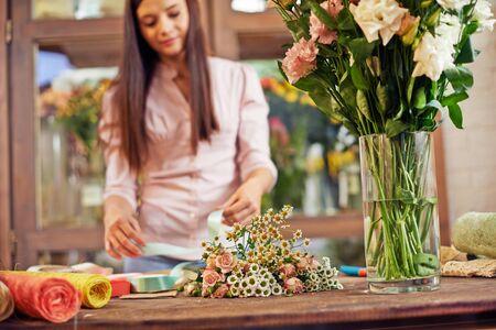 floristics: Floral designer working in shop of floristics