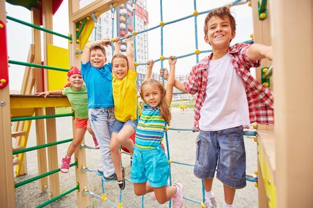 kids having fun: Group of friendly kids having fun outdoors Stock Photo