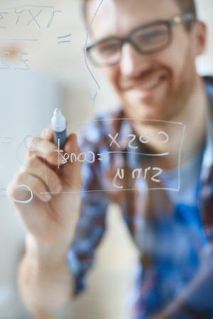 algebraic: Algebraic formula on transparent board written by man