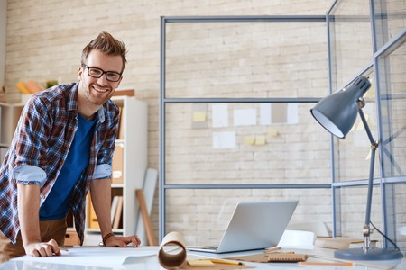architect office: Happy architect looking at camera in office Stock Photo