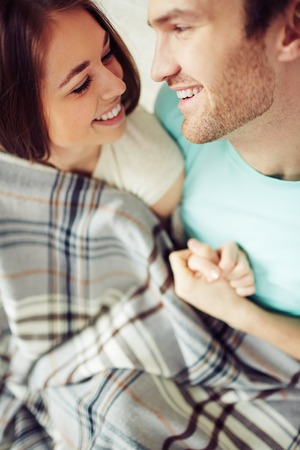 amorous: Amorous couple looking at one another with smiles