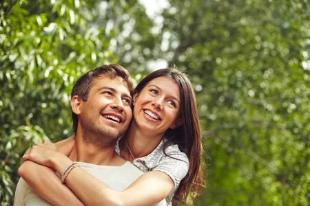 enjoying life: Happy couple enjoying life in natural environment Stock Photo