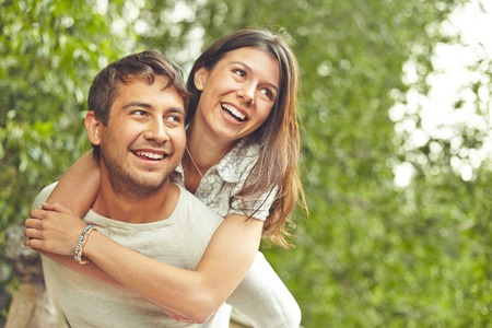 man woman hugging: Cheerful couple spending time outdoors