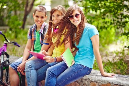 teenagers group: Friendly teenagers resting in park Stock Photo