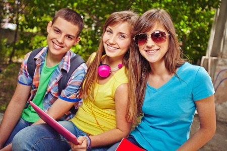 restful: Restful teens looking at camera in park