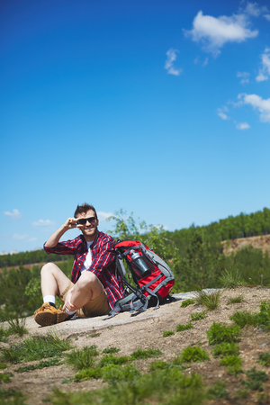 restful: Restful traveler sitting on country road Stock Photo