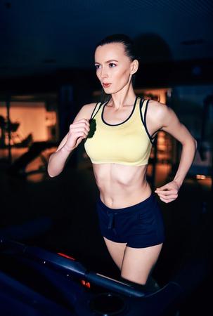 activewear: Fit girl in activewear running on treadmill