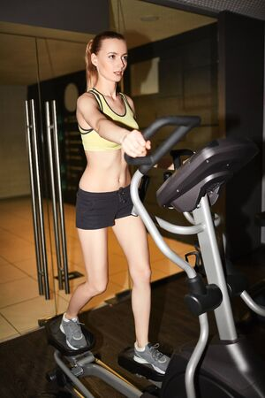 activewear: Fit girl in activewear exercising on sport facilities