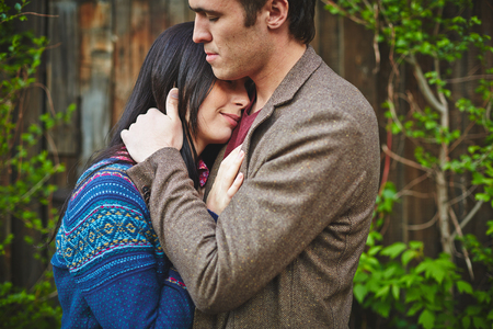 amorous: Amorous couple in casualwear cuddling outside