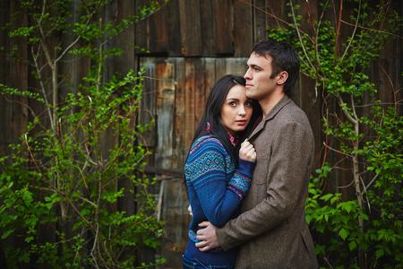 amorous: Amorous couple in casualwear having romantic date outside Stock Photo