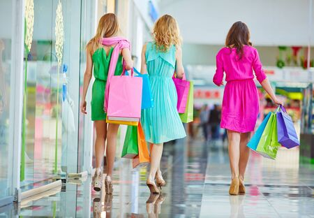paperbags: Group of shoppers carrying paperbags Stock Photo
