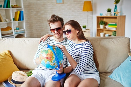 amorous: Amorous couple in sunglasses choosing place for travel and rest Stock Photo