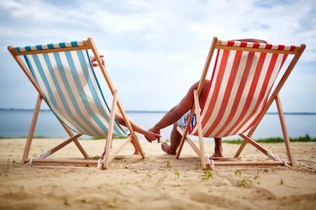 couple relaxing: Restful couple sunbathing on the beach