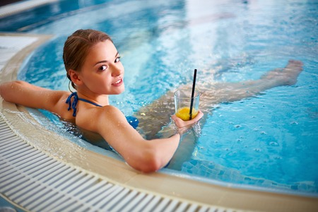 hot tub: Attractive female in bikini relaxing in hot tub Stock Photo