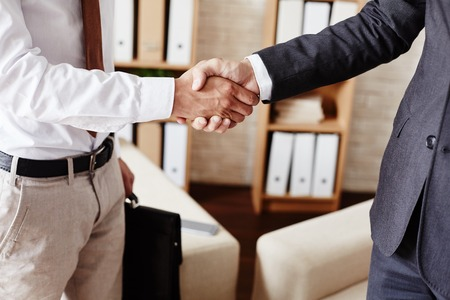 negotiation business: Businessmen handshaking after signing contract Stock Photo