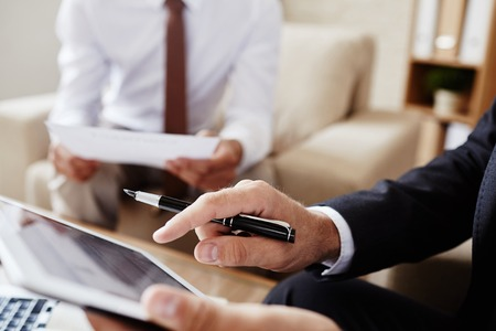 people network: Male employee pointing at screen of digital tablet