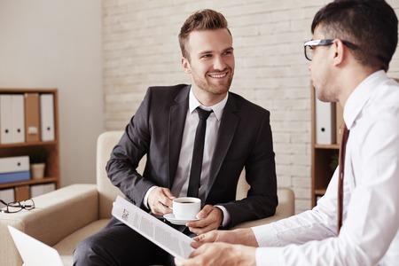 men talking: Modern businessmen communicating at meeting