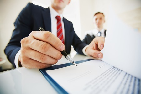 Businessman signing contract after negotiation