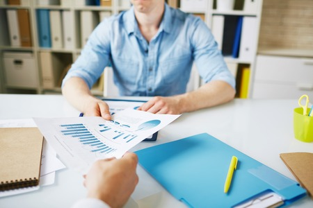 hand paper: Male employee giving document with data to colleague
