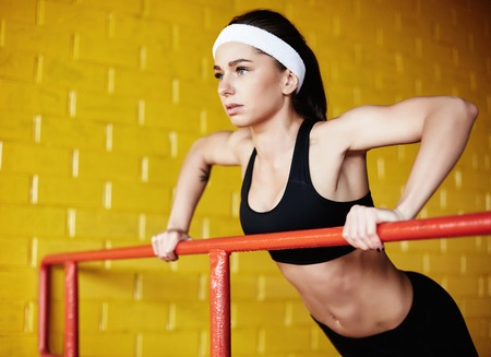 activewear: Young woman in activewear doing physical exercise Stock Photo