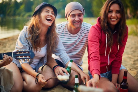 restful: Restful friends spending weekend in natural environment Stock Photo