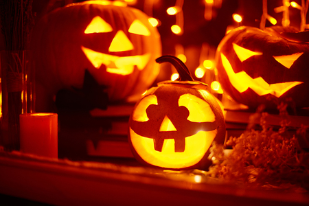 antichrist: Eerie pumpkins burning in window